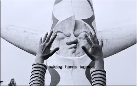 holding hands together・・・。
